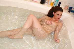 Teen babe Holly gets naughty in the bathtub teasing her perfect tits
