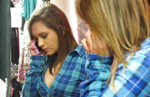 Cute teen babe Spencer Sage exposing her tits in changing room