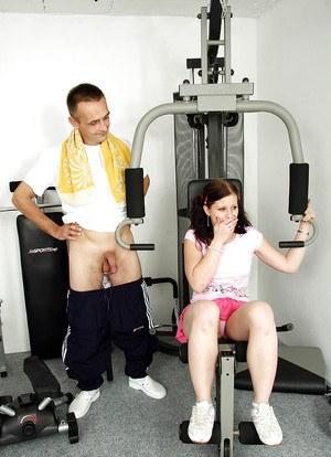Slutty teen babe Lucie V gets a cumshot in her mouth in the gym