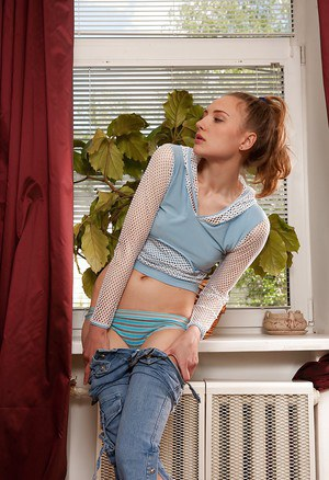 Skinny teen babe Coco exposing her hairy armpits and shaggy twat