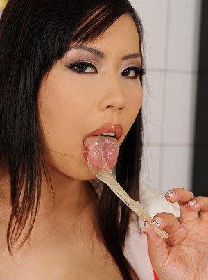 Asian MILF in latex outfit Tigerr Benson playing with condoms full of jizz