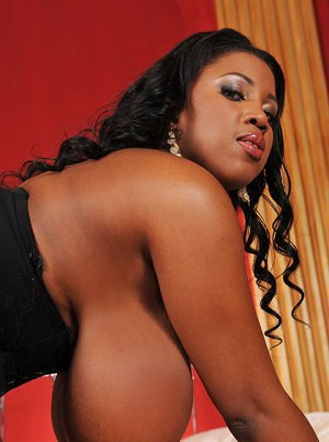 Fatty ebony babe exposing her massive jugs and playing with a toy