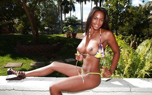 Adorable ebony chick showing off her fuckable body outdoor