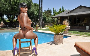 Hot ebony chick Coffee Brown stripping and posing naked by the pool