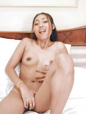 Tempting asian babe taking off her panties and teasing her cunt