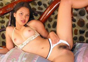 Foxy asian babe in underwear showing off her knockers and hairy pink hole