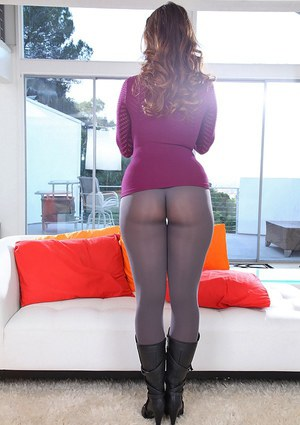 Curvaceous babe taking off her pantyhose and showing off her awesome ass