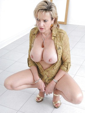 Gorgeous mature lady uncovering her big tits and sweet pussy