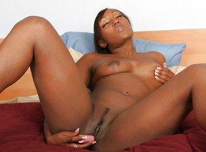 Seductive ebony babe stripping off her lingerie and toying her pussy