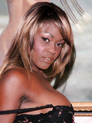 Busty ebony babe Coco Pink stripping and spreading her sexy legs