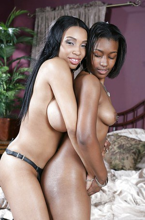 Busty ebony babes on high heels are into hot lesbian action with strapon