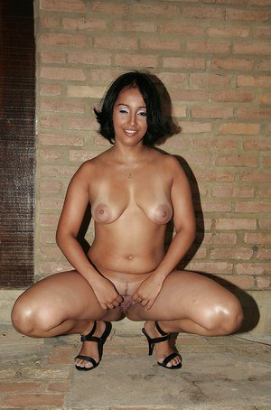 Curvaceous ebony MILF with big ass uncovering her fuckable body