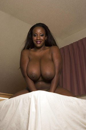 Fatty ebony babe with massive boobs playing with a vibrator
