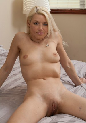 Seductive blonde babe Anikka Albrite stripping and posing naked on the bed