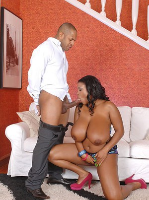 Horny ebony babe gets a cumshot on her giant boobs after hardcore fucking
