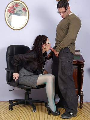Hot mature fetish babe in glasses sucking and jerking a hard cock