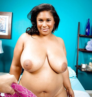 Ebony plumper Delilah Black gets undressed and lets a guy play with her boobs