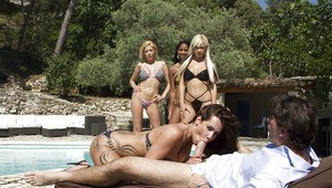 Gorgeous babes in bikini take turns sucking and fucking big cocks outdoor