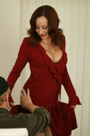Busty mature babe Abigail Fraser strips for a guy and gives him a blowjob