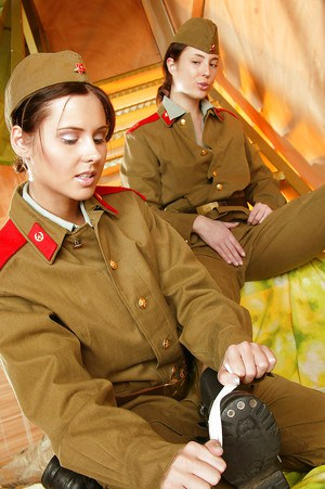 Hot lesbians stripping off their army uniform and playing with their toy