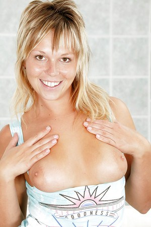Filthy blonde babe with big tits stripping and masturbating her poon