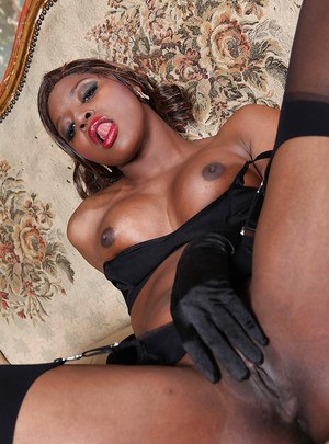 Ebony babe Jasmine Webb uncovering her tits and taking off her panties