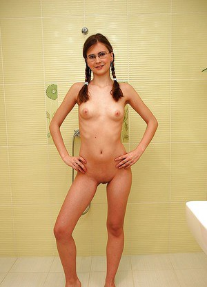 Skinny teen babe in glasses showing off her fuckable body