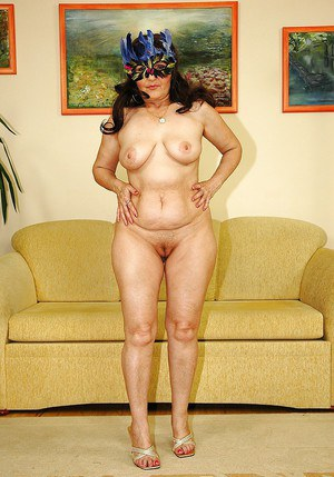 Fatty big titted granny on high heels strips and shows her spread ass