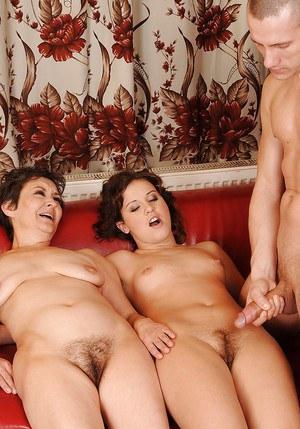 Horny mature babes fuck with a strapon and give blowjobs