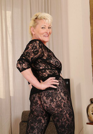 Naughty granny Molly Maria stripping off her sheer lacy suit