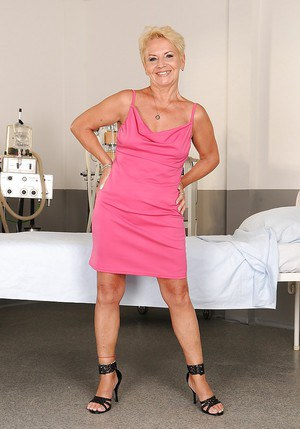 Short haired fatty granny on high heels taking off her clothes