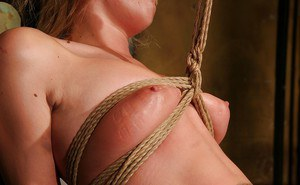 Sexy babe Safira White posing naked and getting bound with rope