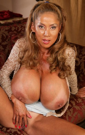 Asian Mature Boob Related Mature Asian babe with huge boobs spreading her hairy pussy