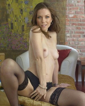 Lovely amateur babe in nylon stockings stripping off her clothes