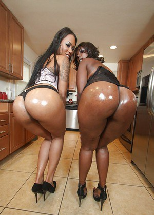 Ebony babes on high heels strip to expose their hot fatty asses
