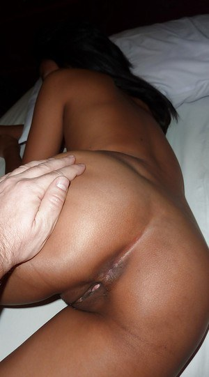 Slutty thai babe with sexy ass and tiny tits gives a handjob