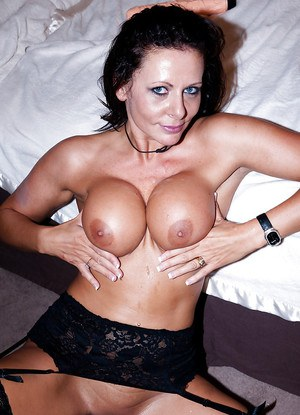 Big busted MILF in stockings gives a blowjob and gets banged hardcore