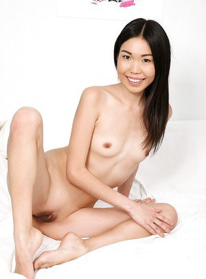Skinny asian schoolgirl taking off her uniform and toying her butthole