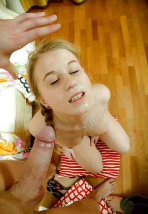 Lusty teen babe with pigtails gets a facial after hardcore fucking