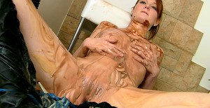 Fetish babe covers her body with chocolate and masturbating her cunt