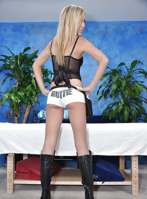 Graceful teen blonde in high heeled boots uncovering her tiny tits