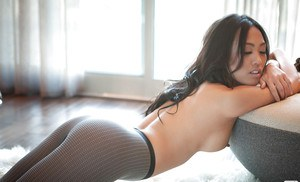 Sexy asian babe Kitty Lee stripping off her lingerie and pantyhose