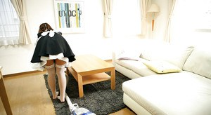 Asian babe in maid uniform Yukari Endo uncovering her titties and hairy cunt