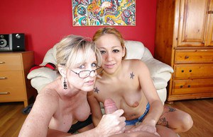 Fuckable mature lady in glasses shares a hard dick with her teen friend