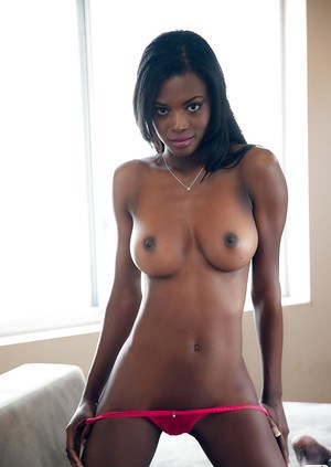 Lovely ebony babe with big tits Danielle Nicole slipping off her lingerie