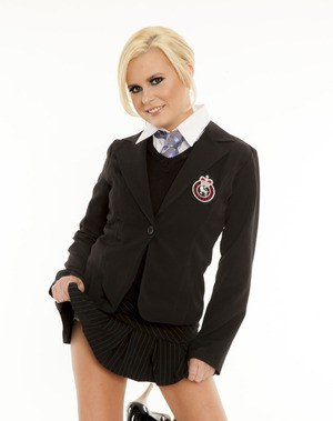 Naughty schoolgirl Kelly Surfer stripping off her uniform and lingerie