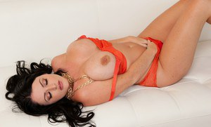 Sexy MILF with big boobs Sophie Dee stripping and spreading her legs