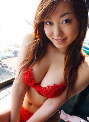 Tempting asian coed uncovering her big tits and bushy cunt