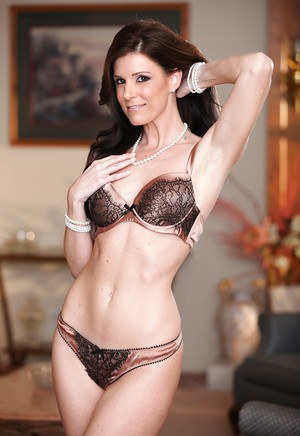 Adorable mature brunette with petite ass posing in lingerie