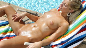 Sexy amateur blonde taking off her bikini and teasing her cunt outdoor